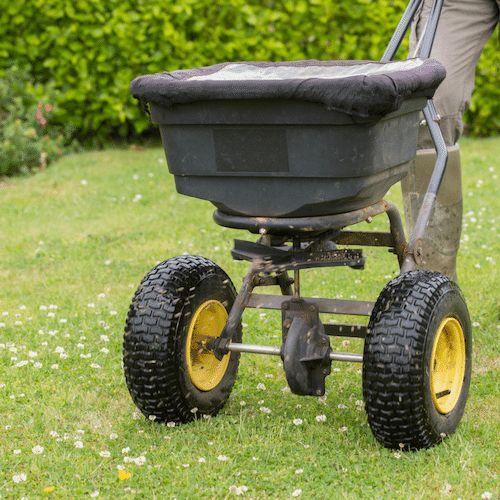 Lawn Fertilisation with push trolley in Frankston